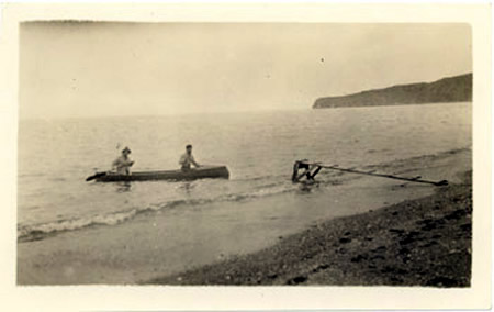 Rev. Calvin and unknown man in canoe