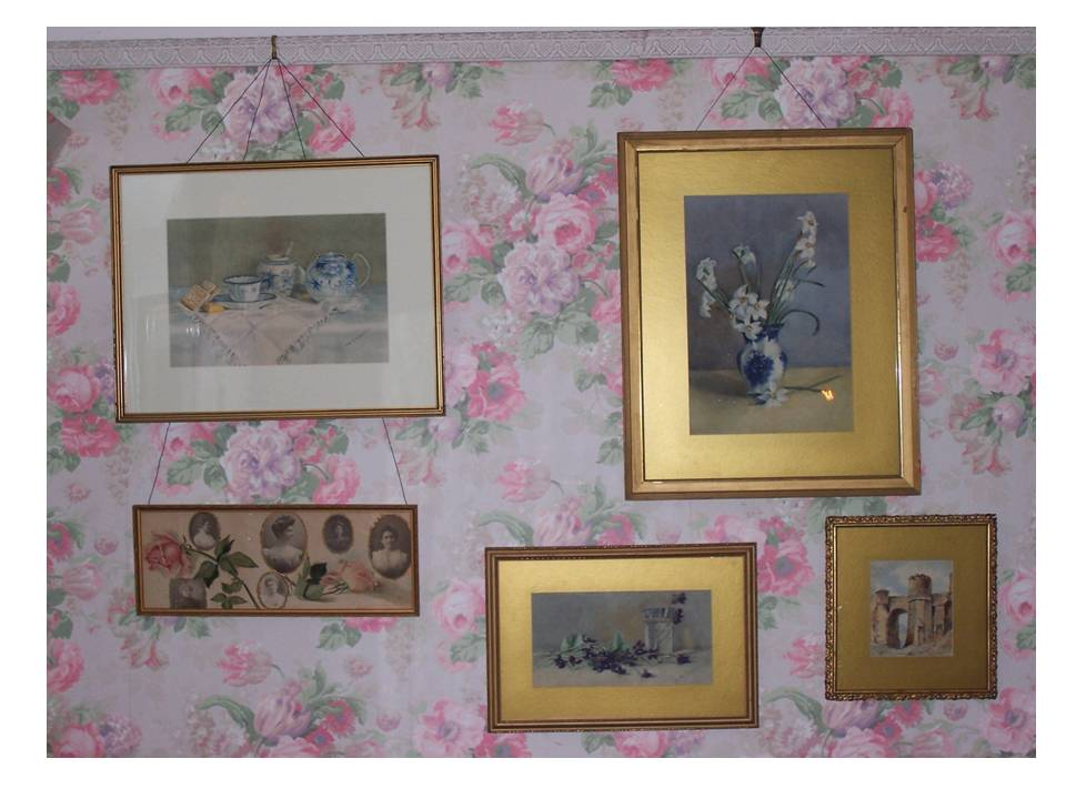 Ruby McQuesten's bedroom at Whitehern showing a few of her paintings and the wallpaper.